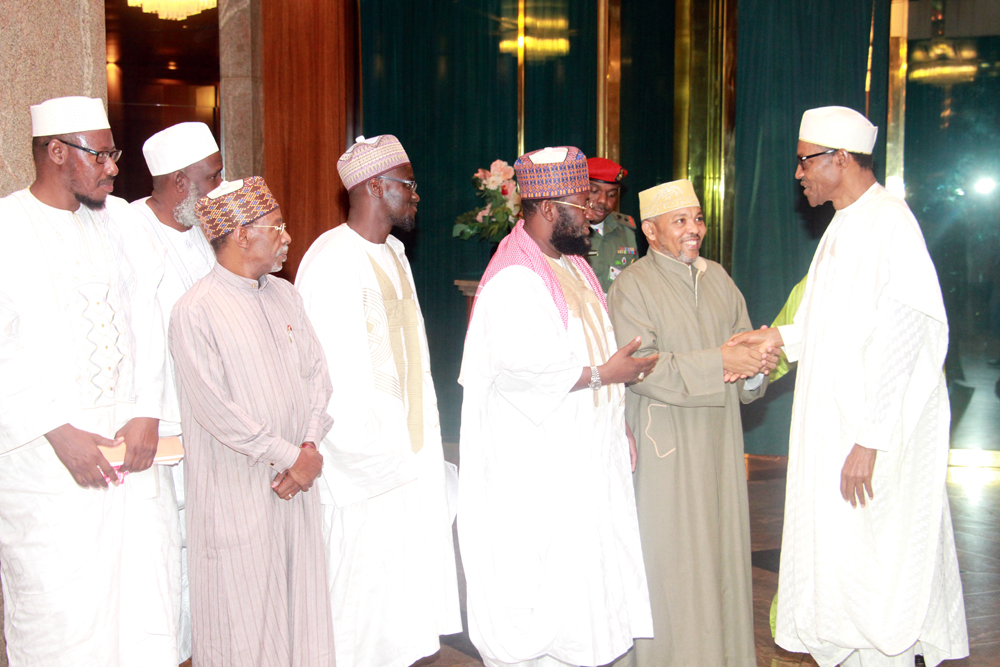 Pix. 4: President Muhammadu Buhari welcoming the President, Union of African Scholars, Dr. Said Bourhani while from the left, the Secretary General, Dr. Seydou Madibaba Sylla; Secretary General, Supreme Council for Shariah in Nigeria, Mall. Nafiu Baba Ahmad; Head of Research, Studies & Translation Committee, Dr. Abdul-Razzaq Abdul-Majeed Alaro and Member of the delegation, Sheikh Abdullah Bala Lao watched during an audience the President granted Islamic Scholars at the State House, Abuja. Photo by Abayomi Adeshida 01/09/2015